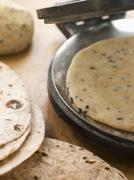 Chapatti Press with Chapatti Breads - stock photo