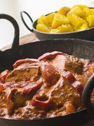 Chicken Tikka Masala with Bombay Aloo Stock Photos