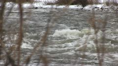 Fast flowing river with slight Bokeh effect Stock Footage