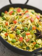 Vegetable Pilau Rice in a Balti Dish - stock photo