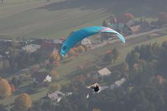 Birdseye view blue fly paraglider aviation sport Stock Photos