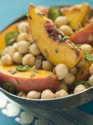 Bowl of Chick Pea and Peach Salad Stock Photos
