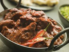 Meat Phall in Karahi with Naan and Green Chilli Curry Stock Photos
