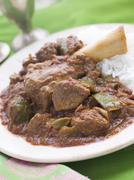 Lamb Shank Rogan Josh Gosht with Plain Basmati Rice - stock photo