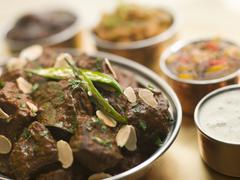 Meat Madras Restaurant Style with Raita and Chutneys Stock Photos