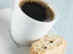 Cup of Espresso Coffee with Hazelnut Biscotti Stock Photos