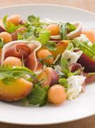 Platter of Cantaloupe Melon Parma Ham Mozzarella Cheese and Peach Stock Photos