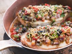 Baked Sicilian Swordfish in a Copper pan - stock photo