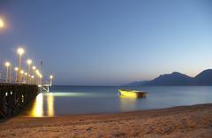 beach summer boat dusk footbridge idyll night - stock photo