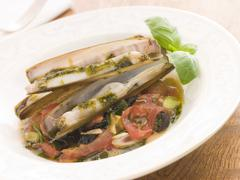 Razor Clams with Stewed Tomatoes Garlic and Olives - stock photo