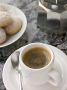 Cup of Espresso Coffee with Amaretti Biscuit - stock photo