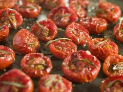 Tray of Oven Dried Tomatoes - stock photo