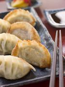 Fried Pork and Shrimp Dumplings with Soy Sauce Stock Photos