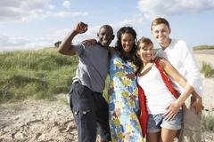 Stock Photo of group of young people having fun on beach together