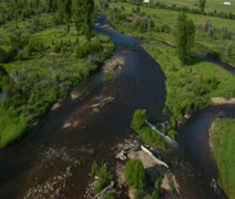 Aerial shot of Green Valley, River, and ranch Stock Footage