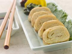 Rolled Dashi Omelette with Pickled Vegetables Soy and Shiso Stock Photos