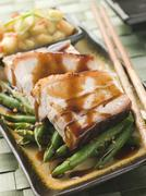 Roast Belly Pork with Fuji Apples and Peanut Beans Stock Photos