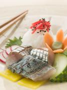 Sashimi of Mackerel with Pickled Daikon Salad and Vinegar Rice Stock Photos