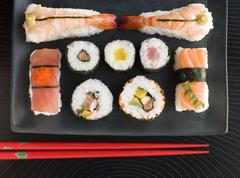Selection of Seafood And Vegetable Sushi With Chopsticks (Overhead) - stock photo