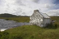 hut idyll lake romantic stone in irish landscape - stock photo