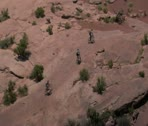 Stock Video Footage of aerial shot of Redrock Mountain biking Moab Utah