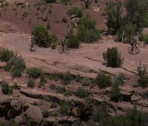 aerial shot of Redrock Mountain biking Moab Utah - stock footage