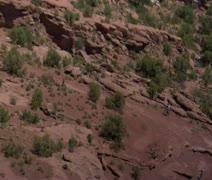 Aerial shot of Redrock Mountain biking Moab Utah Stock Footage