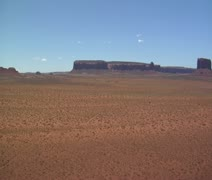 Red rock desert with distant buttes Stock Footage