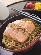 Sesame Crusted Salmon Fried Noodles and Pickles Stock Photos