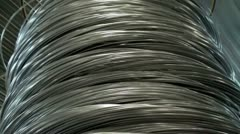 Spools with a thick wire in the production department of nails Stock Footage