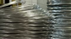 Spools with a thick wire in the production department of nails - stock footage