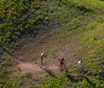 Aerial shot of three mountain bikers on Green Mountain Stock Footage