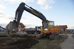 Site dig digger home soil excavator excavation Stock Photos