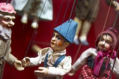 Stock Photo of doll marionette puppets game society dliches
