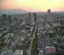 Aerial shot of downtown Salt Lake City, sunset, and Cathedral Stock Footage