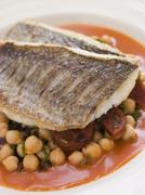 Fillets of Sea Bream with Chorizo Sausage Chickpeas and Tomato Sauce Stock Photos