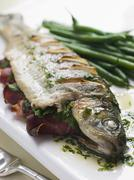 Whole River Trout with Jamon and Herb Butter Stock Photos