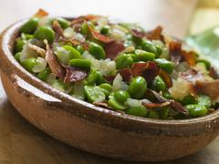 Baby Broad Beans and Ham- Jamon au Favas - stock photo