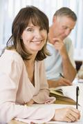Adult students studying at table (selective focus) - stock photo