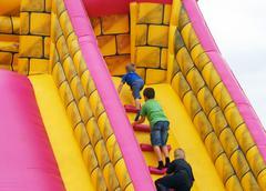 children in bumper castle - stock photo