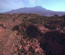 Aerial shot of red cliffs and mountains St. George Utah Stock Footage