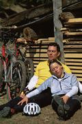 Cyclists resting after cycle ride - stock photo