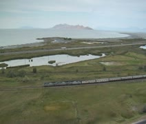 Aerial shot of Amtrak train and great salt lake Stock Footage