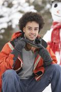 Stock Photo of man wearing winter clothes in snowy landscape