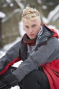 teenage boy wearing winter clothes in snowy landscape - stock photo