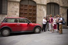 Car old town red tourist mini tourists economy Stock Photos