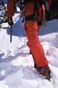 Mountain climber going up snowy mountain (selective focus) Stock Photos