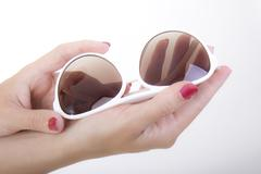 Hand hold styling sunglasses held hands red body Stock Photos