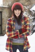 woman in snowy landscape wearing warm clothing - stock photo