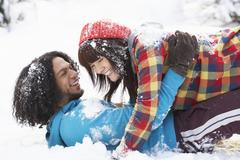 romantic teenage couple having fun in snow - stock photo